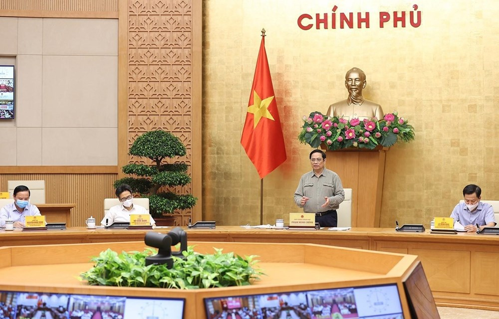 PM asks for safely adapting to pandemic hinh anh 1