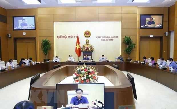 Legislators debate draft resolutions on development of Hai Phong, Nghe An, Thua Thien-Hue hinh anh 1
