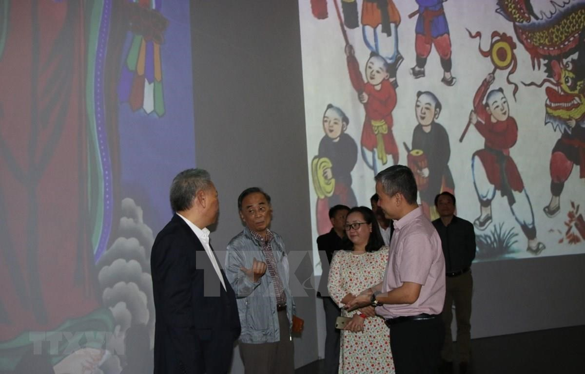 More than 100 Hang Trong paintings presented in the 3D mapping technology, in combination with modern sound and light. (Photo: VNA)
