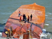 Two sailors of sunken ship on southern river still missing