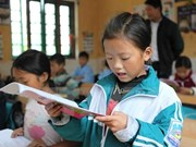 Young Vietnamese students improving reading abilities