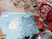 Malaysian air crash: debris, female body found