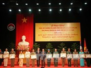 Laos honours Vietnamese voluntary soldiers, experts