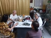 Doctors treat patients for free at clinic in Hanoi