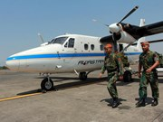 Indonesian plane crash victim bodies retrieved