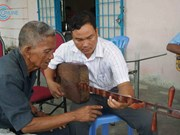 Khmer youths learn to play traditional musical instrument