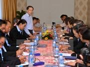 Vietnamese, Lao journalists exchange professional skills