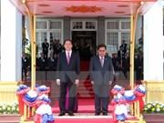 President Tran Dai Quang starts State visit to Laos