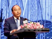 PM urges Hanoi to remove barriers for stronger development