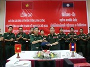 Vietnam presents computers to Laos's military units