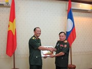 Young Vietnamese, Lao officers join exchange activities