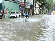 Heavy rain floods some Hanoi streets