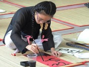 Young artist writes the beauty of Vietnamese calligraphy