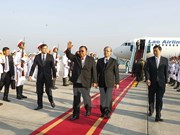 Lao Party chief, President welcomed at Noi Bai airport