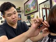 Deaf hairdresser: A cut above