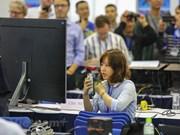 Foreign reporters follow President Trump's landing in Vietnam