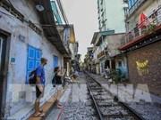 "Extreme sport along the ""railway"" street in Hanoi"