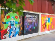 Murals on Hanoi street encourage public to join hands in COVID-19 fight