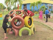 Children have fun with playgrounds from recycle materials
