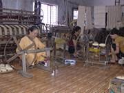 Woman weaves silk from lotus