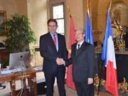 Party delegation visits France