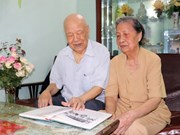 Old couple's honour when serving Uncle Ho