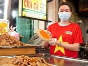 Market vendors in Da Nang show determination to win COVID-19 fight