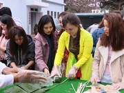 Foreign students eager to experience Tet traditions