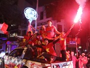 Football fans storm streets to celebrate U23 victory