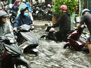 Heavy rain submerges streets in Ho Chi Minh City