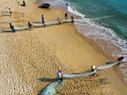 Fishermen pull in nets in Da Nang city