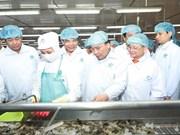 PM tours shrimp processing corporation in Ca Mau