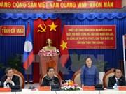Laos' top legislator encourages local cooperation