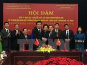 Hanoi VFF Committee boosts ties with Beijing counterpart