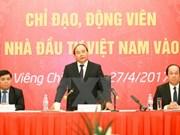 PM praises efforts of Vietnamese investors in Laos