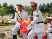Remains of 107 martyrs repatriated from Laos reburied in Nghe An