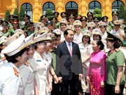 President Tran Dai Quang meets outstanding policewomen