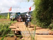 Dak Nong builds concrete bridge in remote area