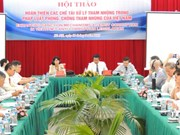 Seminar seeks to improve Vietnam's sanctions against corruption