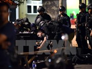 Suspected militant shot dead after stabbing Indonesian policemen