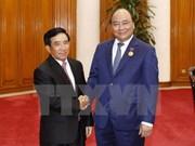 PM Nguyen Xuan Phuc pledges continuous support for Laos's nation build