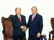 PM lauds Vietnam- Laos cooperation in home affairs