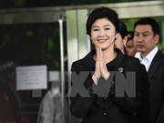 Thailand considers revoking former PM Yingluck's passports