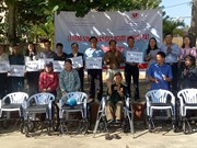 Disabled people in Quang Binh receive wheelchairs