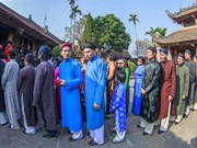 "Artists, ambassadors bringing back ""ao dai"" for men"