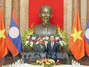 President Tran Dai Quang hails Lao leader's visit