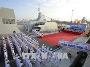 Flag-hoisting ceremony held on two missile escort warships