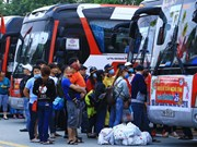 Free coaches bring workers home for Tet