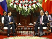President Tran Dai Quang meets with Lao PM Thongloun Sisoulith