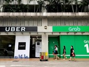 Singapore sets interim measures for Grab-Uber merger